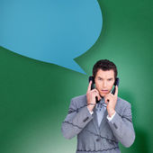 Angry businessman tangled up in phone — Stock Photo