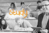 Study against lecturer standing in front of his class in lecture hall — Stock Photo