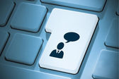 Composite image of businessman and speech bubble on enter key — Stock Photo