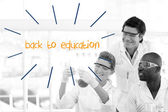 Back to education against scientists working in laboratory — Stock Photo