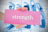 Woman holding pink card saying strenght — Stock Photo
