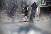 Businesswoman performing a balancing act — Stock Photo