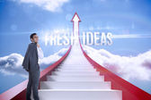 Fresh ideas against red steps arrow pointing up against sky — Stock Photo