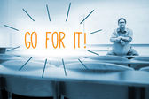 Go for it! against lecturer sitting in lecture hall — Stock Photo