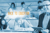 Back to education against lecturer standing in front of his class in lecture hall — Stock Photo
