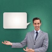 Businessman presenting something — Stock Photo