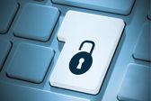 Composite image of lock on enter key — Stock Photo