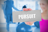 Fit blonde holding card saying pursuit — Stock Photo