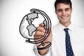 Businessman drawing globe — Stock Photo