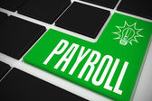Payroll on black keyboard — Stock Photo