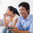 Woman being ignored by boyfriend playing video games — Stock Photo #45102053