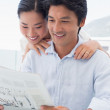 Couple reading a newspaper together — Stock Photo #45103469