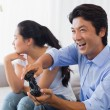 Woman being ignored by boyfriend playing video games — Stock Photo #45103525