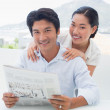 Couple reading a newspaper together — Stock Photo #45104513