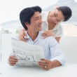 Couple reading a newspaper together — Stock Photo #45105147