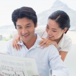 Couple reading a newspaper together — Stock Photo #45107069