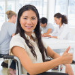 Businesswoman in wheelchair with team — Stock Photo