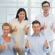 Business team showing thumbs up — Stock Photo