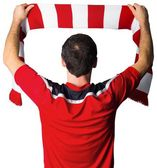 Football fan in red holding scarf — Foto Stock