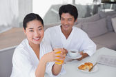Couple in bathrobes spending the morning together — Stock Photo