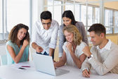 Business team using laptop — Stock Photo