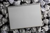 Paper notebook on crumpled paper — Stock Photo