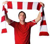 Football fan in red holding scarf — Foto Stock