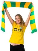 Excited football fan in brasil tshirt — Stockfoto
