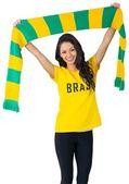 Excited football fan in brasil tshirt — Foto Stock