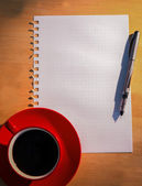Overhead of graph paper coffee and pen — Stock Photo