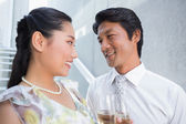 Happy couple dressed up for a date having champagne — Foto Stock