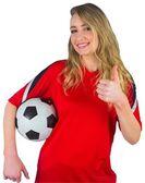 Pretty football fan in red — Foto Stock