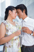 Happy couple dressed up for a date having champagne — 图库照片