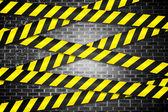 Cordon tape over grey wall — Stock Photo