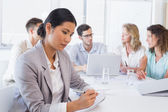 Casual businesswoman taking notes during meeting — Stock Photo