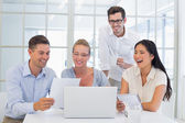 Business team laughing together — Stock Photo