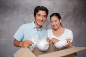 Happy couple unpacking moving boxes — Stock Photo