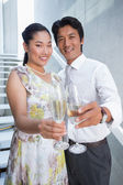 Happy couple dressed up for a date having champagne — Stok fotoğraf