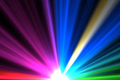 Bright colourful laser beams shining — Stock Photo