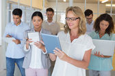 Boss standing in front of her team — Stock Photo