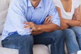 Couple sitting on the couch — Stock Photo