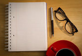 Overhead of notepad and pen — Stock Photo