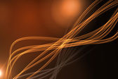 Curved laser light design in orange — Stock Photo