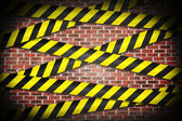 Cordon tape over red wall — Stock Photo