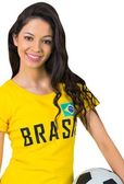 Football fan in brasil tshirt — Stockfoto
