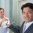 Estate agent giving house key to buyer — Stock Photo #45111327