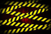 Yellow and black cordon tape — Stock Photo