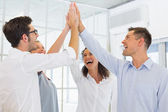 Business team high fiving — Stock Photo