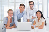 Business team together at desk — ストック写真