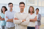 Casual business team with arms crossed — Stock Photo